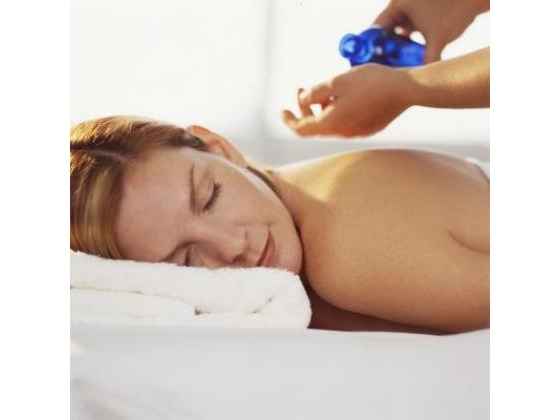 Woman getting a lotion massage while lying on a spa  treatment table