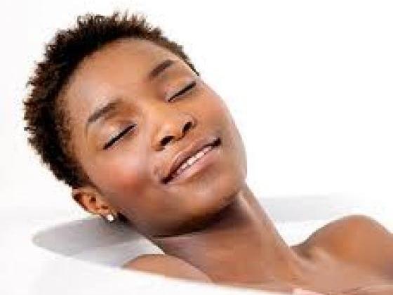 Black girl relaxing during skin care