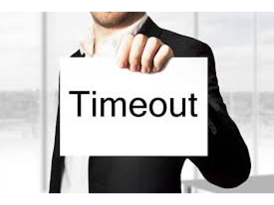 Guy holding time out sign