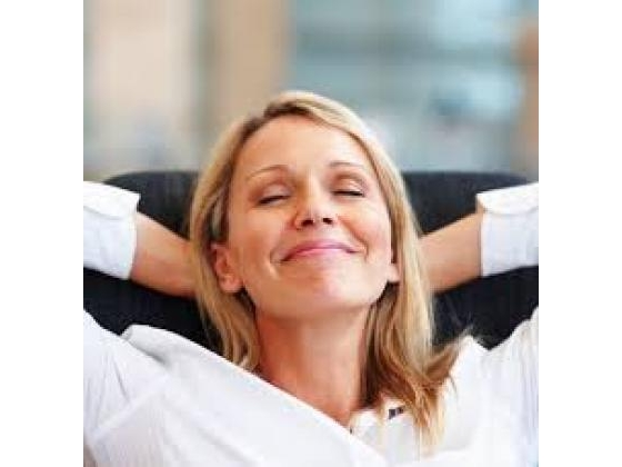 Smiling  woman relaxing alone
