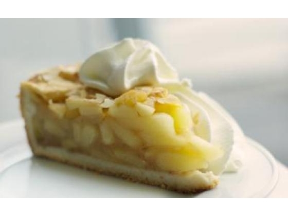 Slice of apple pie with whipped cream.