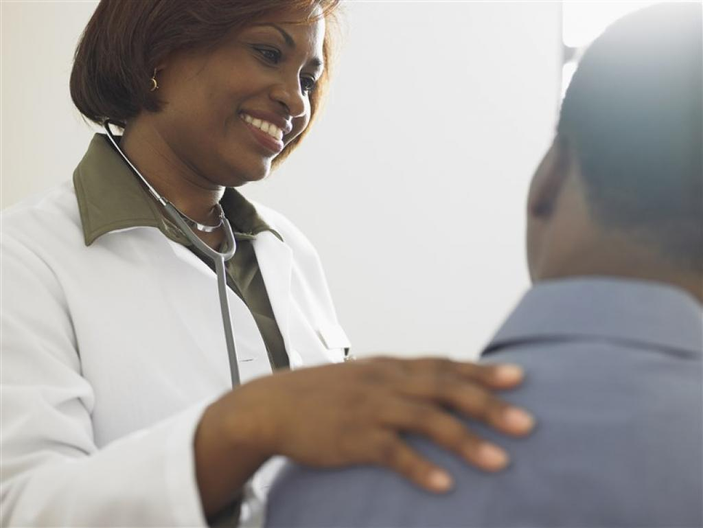 Black female doctor talking to patient