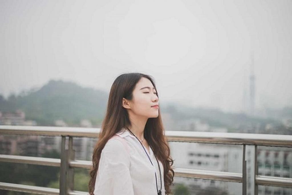 Young Asian girl look peaceful