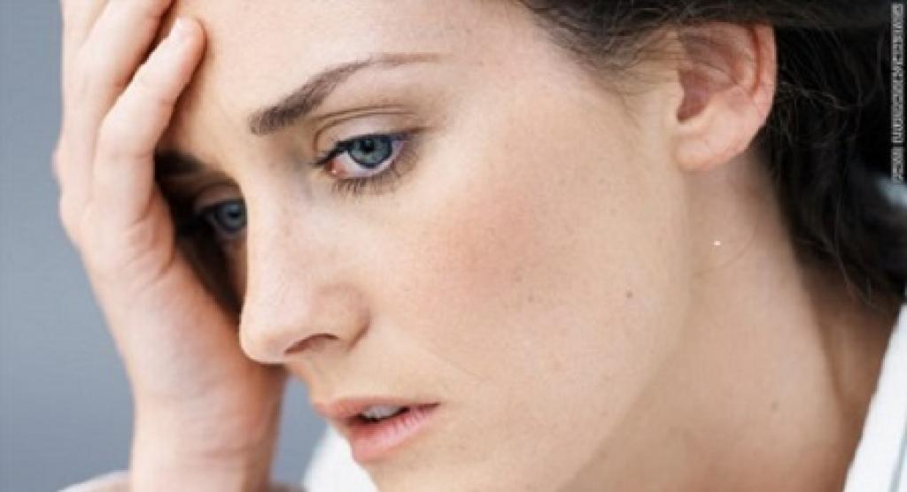 Woman hold forehead looking stressed