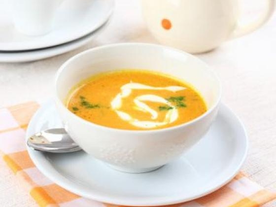 Carrot soup in a bowling with garnish
