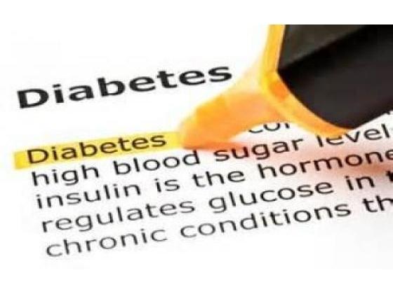 A pen writing the word diabetes