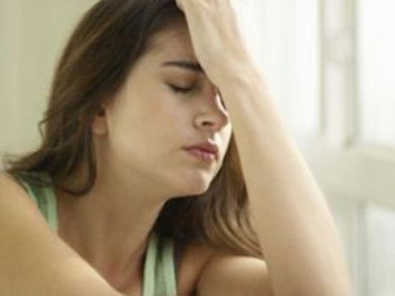 Girl with hand on head very depressed