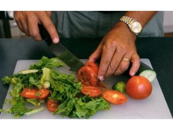 Man preparing vegtable salad
