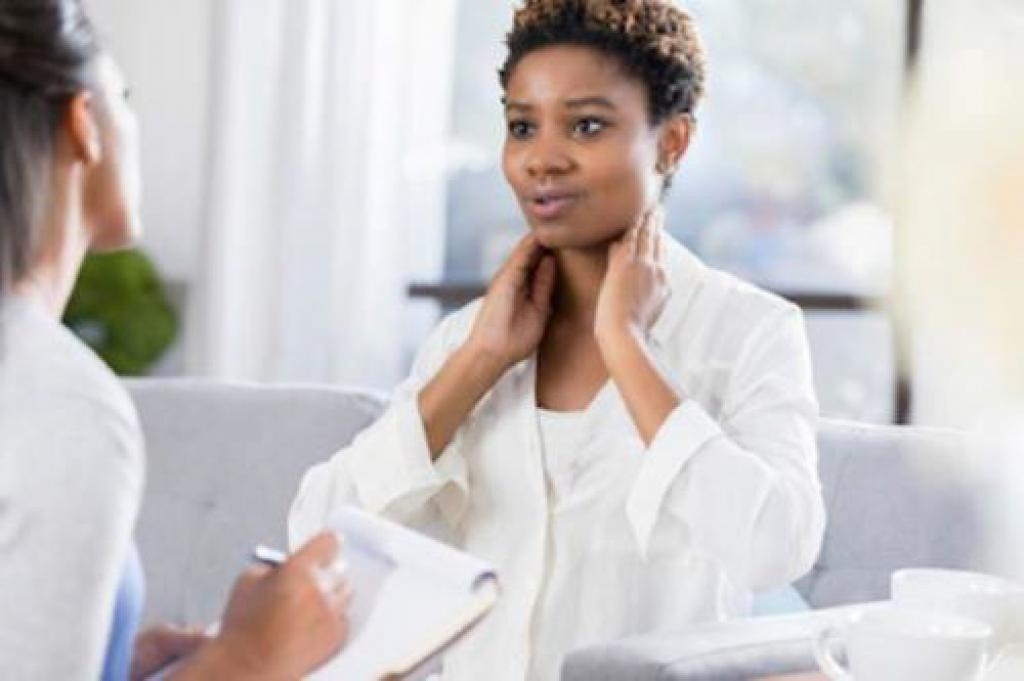doctor discussing neck changes with client.