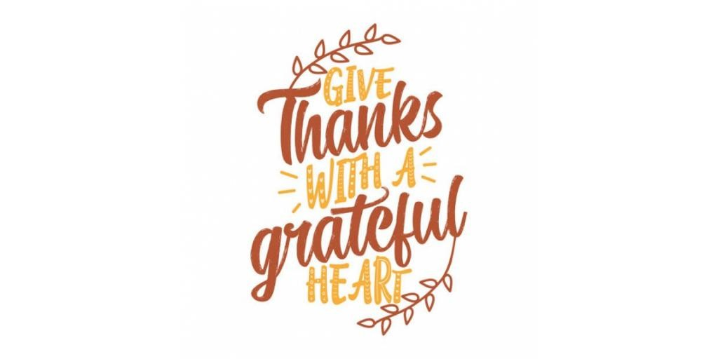 Card with words give thanks with a grateful heart