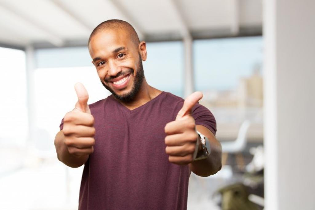 Black man with thumbs up smiling happy expression
