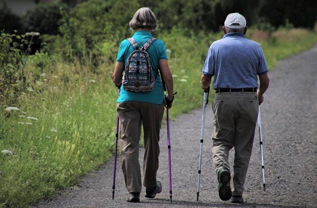 Older woman and man walking a path