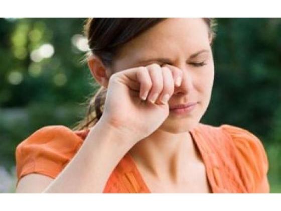 Woman rubbing sore eyes