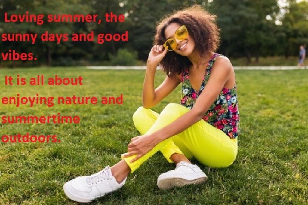 girl sitting on grass smiling enjoying a summer day