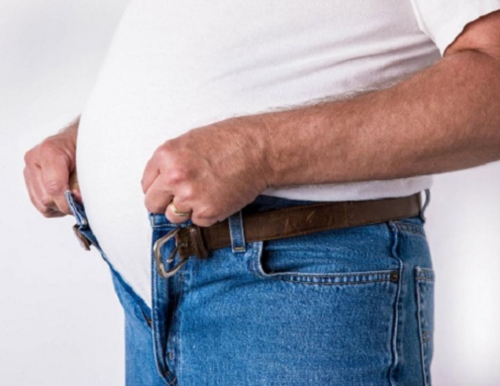 Man unable to zip up pant due to increased weight