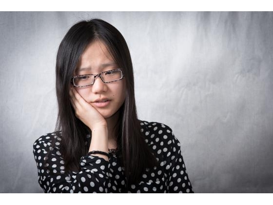 Young girl looking puzzled and stressed