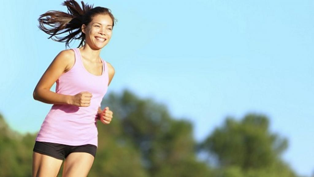 Girl running smiling looking healthy and happy