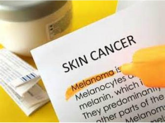 Piece of paper with words about skin cancer.