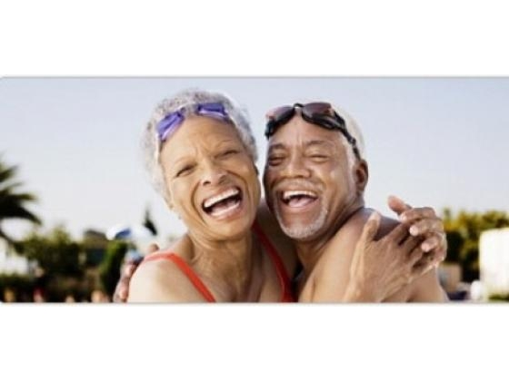 Healthy looking senior couple smiling and hugging