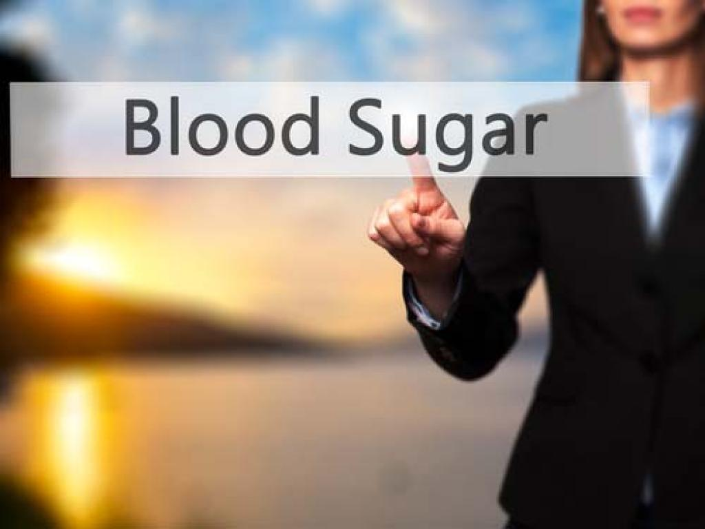 Woman holding a sign stating blood sugar
