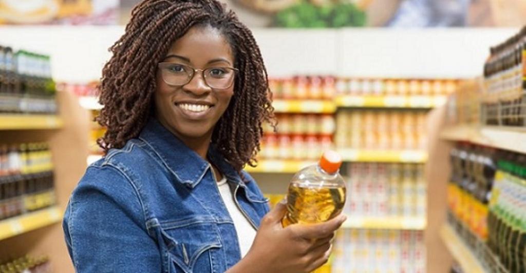 Smiling healthy Black girl shopping