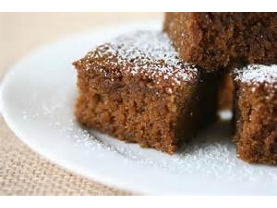 Three gingerbread squares on a plate.