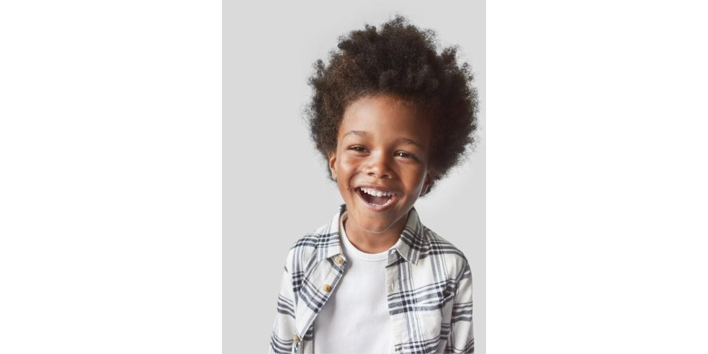 Young boy smiling happily