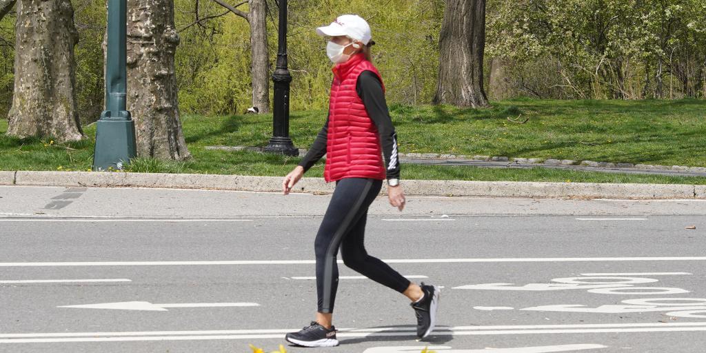 Woman walking  outdoorswith mask on