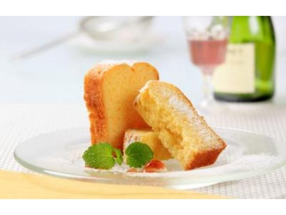 Two slices of delicious pound cake with sauce