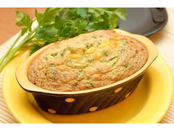 Casserole in a serving dish on a yellow plate.